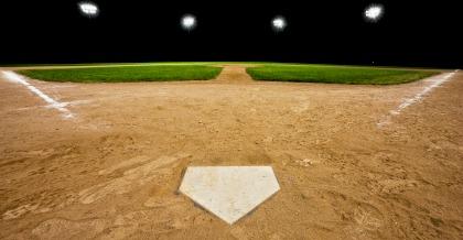Baseball diamond (hardball) at night with stadium lights on
