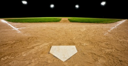 Baseball diamond (hardball) at night with stadium lights on